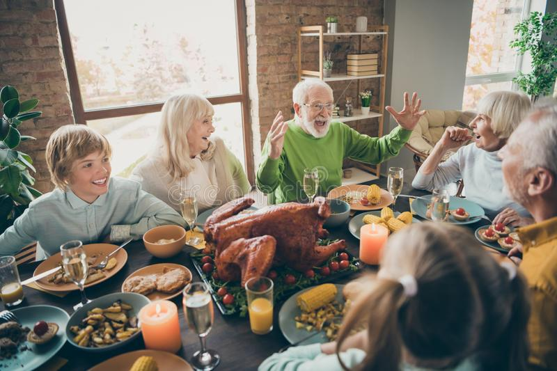 Photo of full family reunion gathering sit feast dishes chicken table communicating fall november autumn holiday multi. Photo of full family reunion gathering royalty free stock image