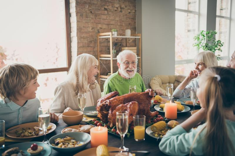 Photo of full family reunion gathering sit feast dishes turkey dinner table communicating fall november holiday multi stock photography