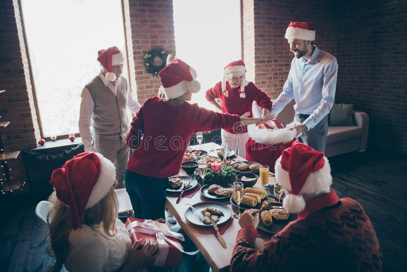 Photo of full harmony family gathering near dinner table generation reunion sharing x-mas presents getting out large. Photo of full harmony family gathering near royalty free stock image