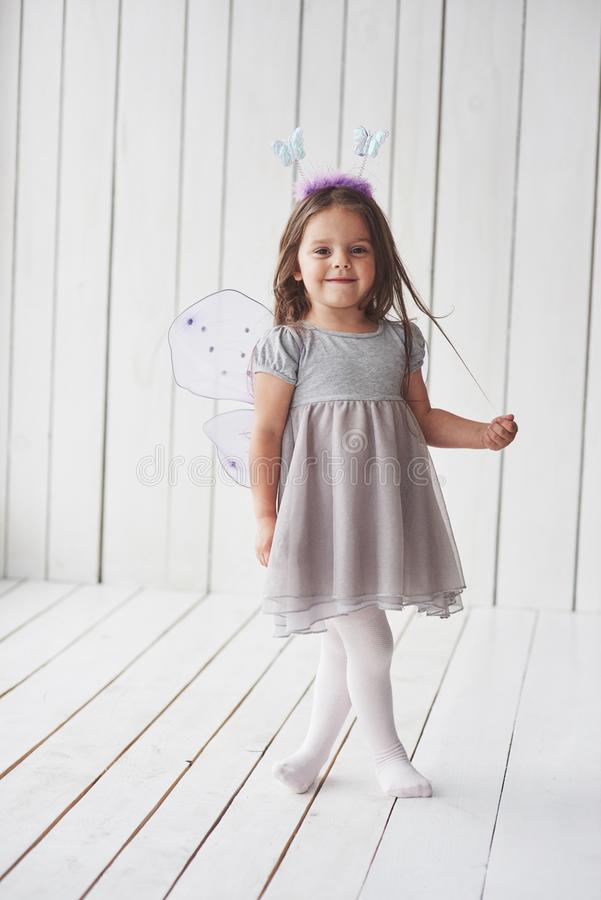 Photo in full height. Beautiful little girl with fairy costume having fun posing for the pictures stock photo