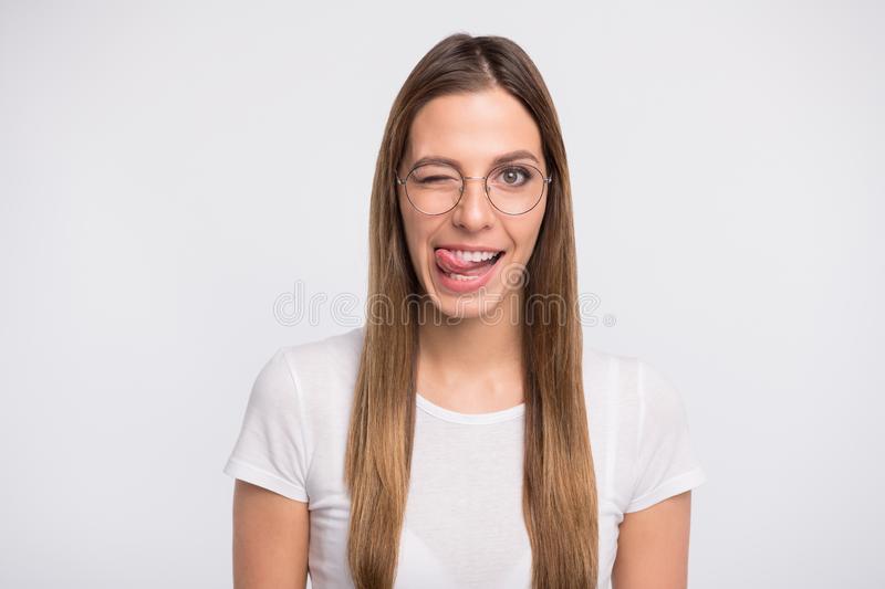 Photo of funky lady tempting lick lips and blink eye wear specs and t-shirt isolated white background. Photo of funky lady tempting lick lips and blink, eye wear stock image
