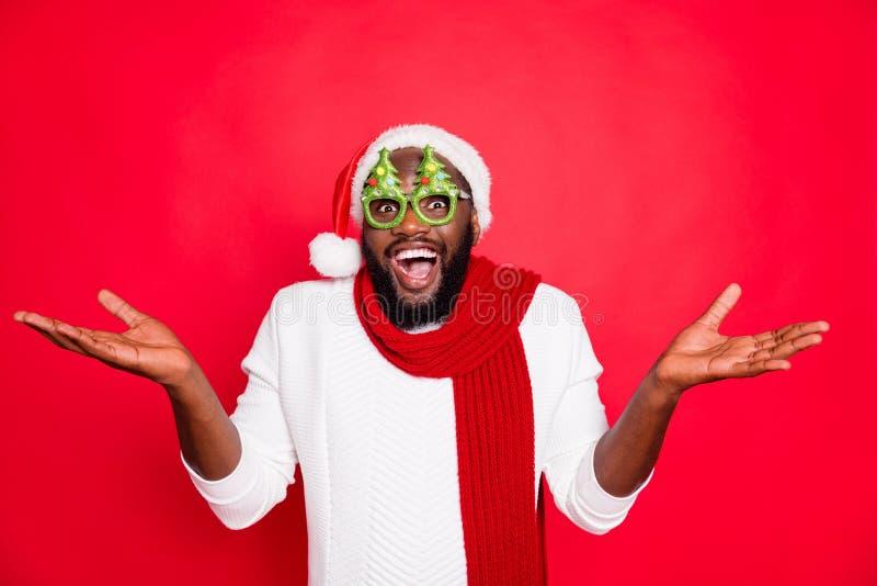 Photo of funny dark skin man in amazing celebrating mood wear x-mas evergreen tree specs white santa cap scarf and. Photo of funny dark skin man in amazing royalty free stock photos