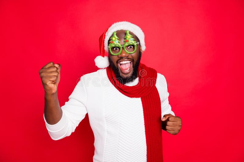 Photo of funny dark skin man in cool mood meeting guests at newyear party wear x-mas evergreen tree specs white santa. Photo of funny dark skin man in cool mood stock photography