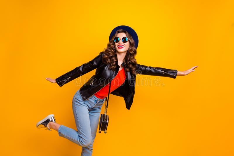 Photo of funny lady spread hands calling taxi auto wear casual stylish outfit isolated yellow color background. Photo of funny lady spread hands calling taxi stock photos