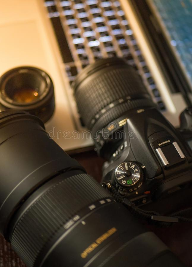 Photo gear on working place, camera and lenses stock image
