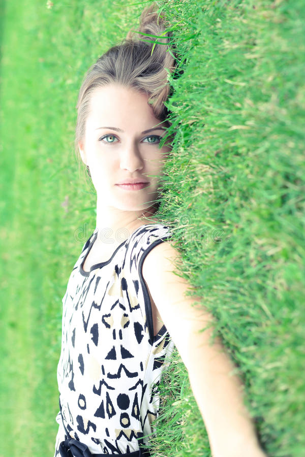 Photo of a girl on the green grass royalty free stock photography