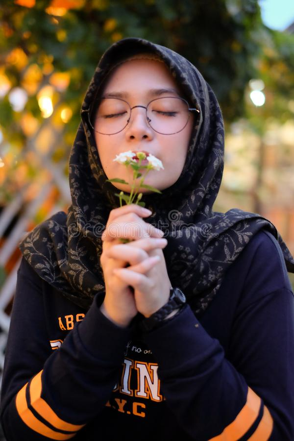 Photo of Girl Smelling White Petaled Flowers stock image