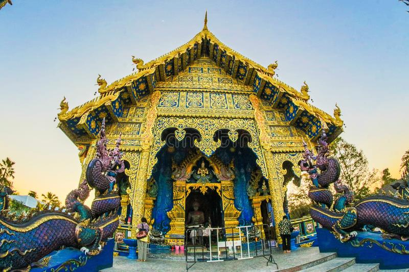 Photo of Gold-colored Altar With Dragon Figurines royalty free stock photo