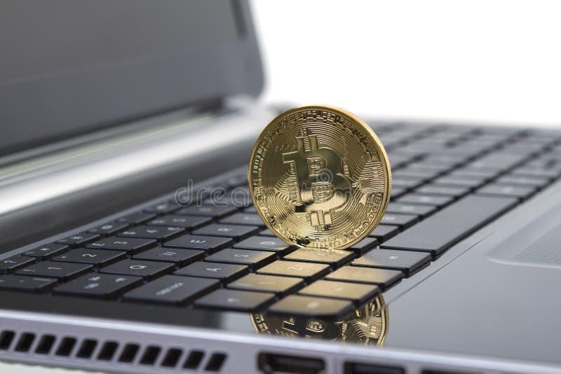 Photo Golden Bitcoin (new virtual money ) royalty free stock photo