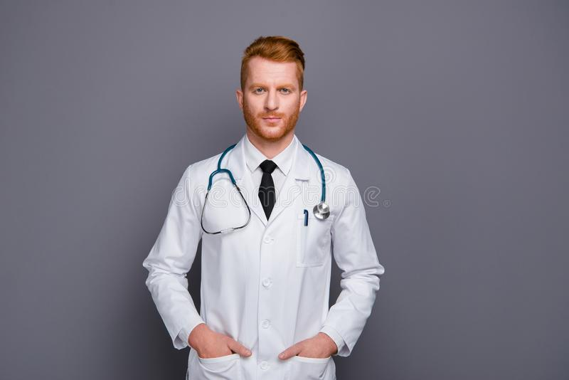 Photo of good-looking doc man look at camera with calm face hold stock photography