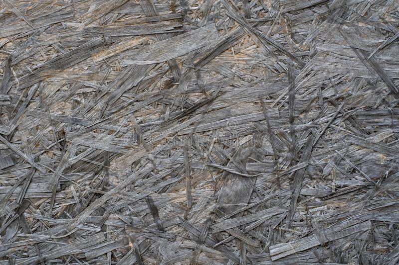 Photo of the grey chipboard texture in close view stock photo