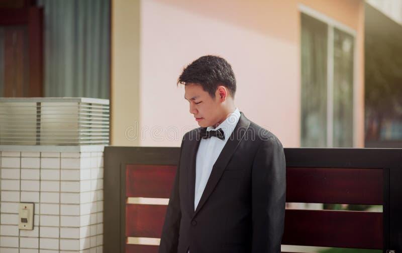 Photo of the Groom Wearing His Tuxedo stock photos