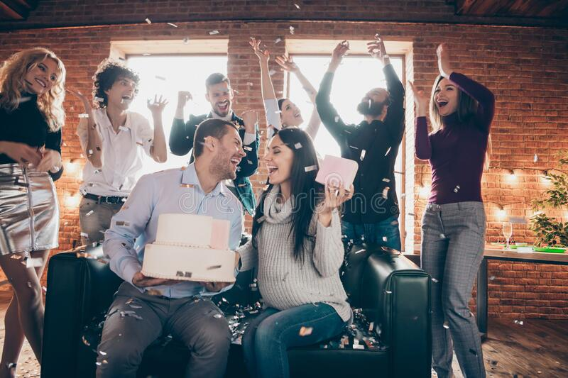 Photo of group amazing friends meeting surprise baby party wedding anniversary future parents sit sofa hold big cake stock images