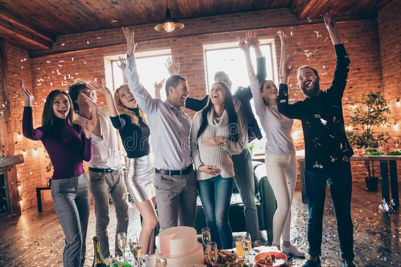 Photo of group amazing friends throwing confetti surprise baby born party meeting future parents raising hands big cake stock image