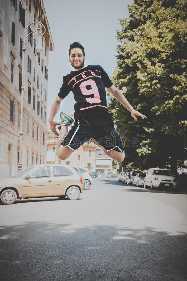Photo of a Guy Jumping on Road stock photography