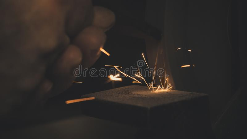 Photo of Hand With Spark stock photo