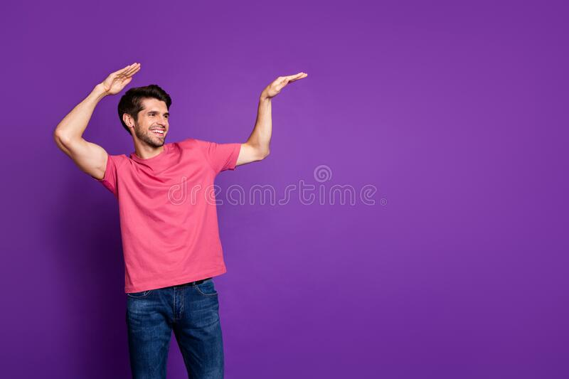 Photo of handsome attractive guy young millennial dancing strange youth moves beaming friendly smiling wear casual pink. Photo of handsome attractive guy young stock photography