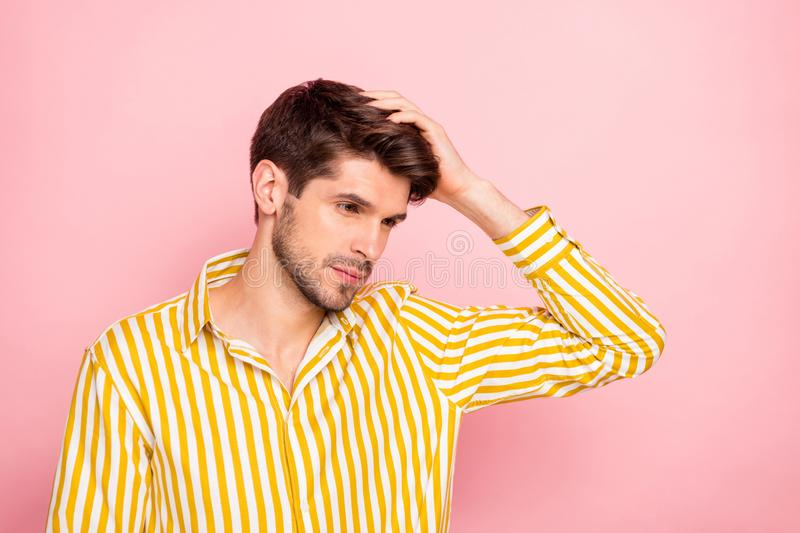 Photo of handsome guy holding hand in perfect hairdo style beauty treatment concept serene mood wear hipster striped stock photos