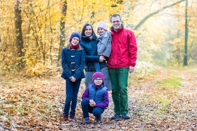 Photo of happy family looking at camera outdoors stock photos