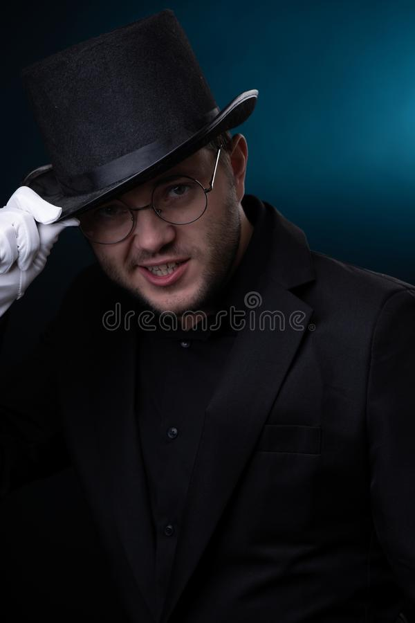 Photo of happy man in black hat in white gloves royalty free stock photography