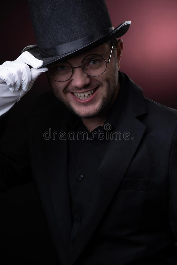 Photo of happy man in black hat in white gloves stock photo