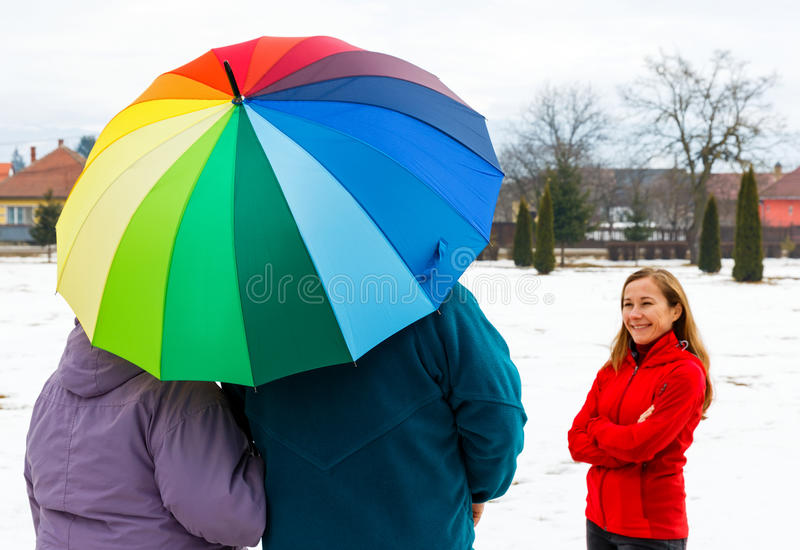 Elderly couple and young caregiver. Photo of happy young caregiver and elderly couple stock photos
