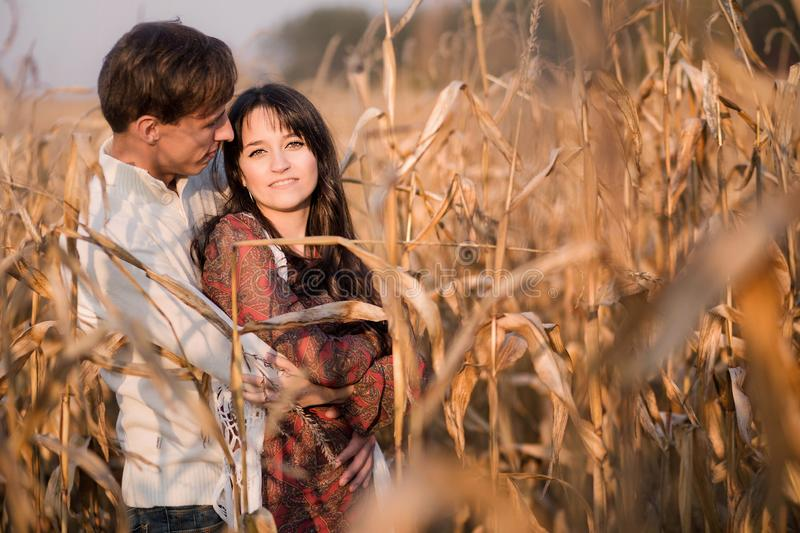 Happy young couple in autumn corn field royalty free stock photos