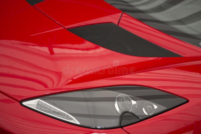 Photo of headlamp and hood of a fast Lotus Evora sportscar. stock photo