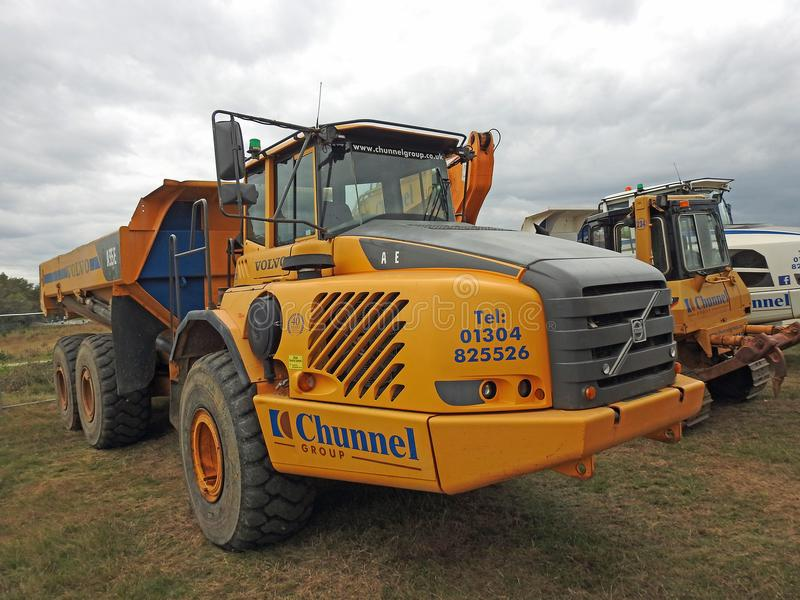 Heavy plant machinery. Photo of heavy plant earthwork earthmovers lorries working on coastline defence measures in whitstable kent oct 2017 stock image