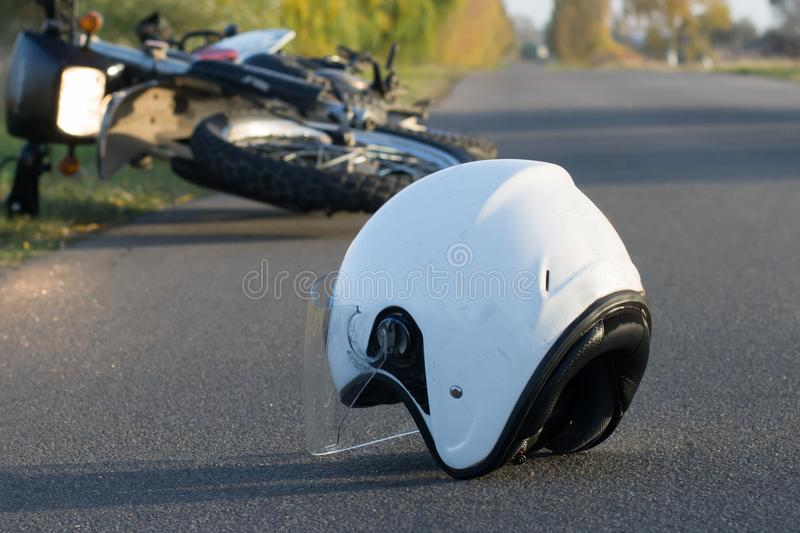 Photo of helmet and motorcycle on the road, the concept of road royalty free stock image