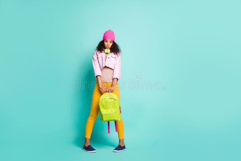 Photo of hesitating shy cute nice charming girlfriend holding school bag with hands uncertain to know information in stock photo