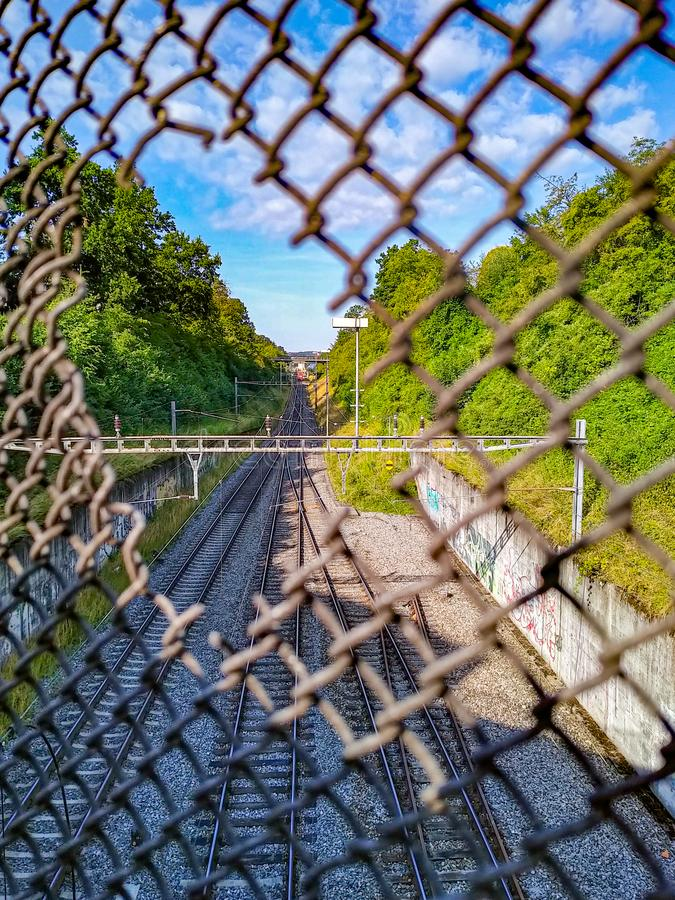 photo of hole in metal network royalty free stock photos