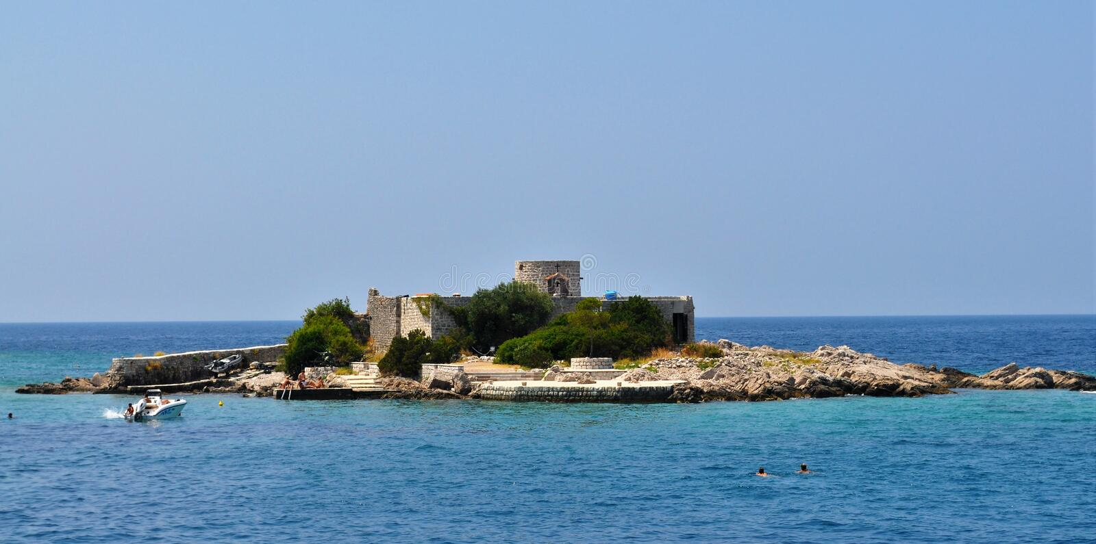 The island, the boat and Theotokos Convent royalty free stock image