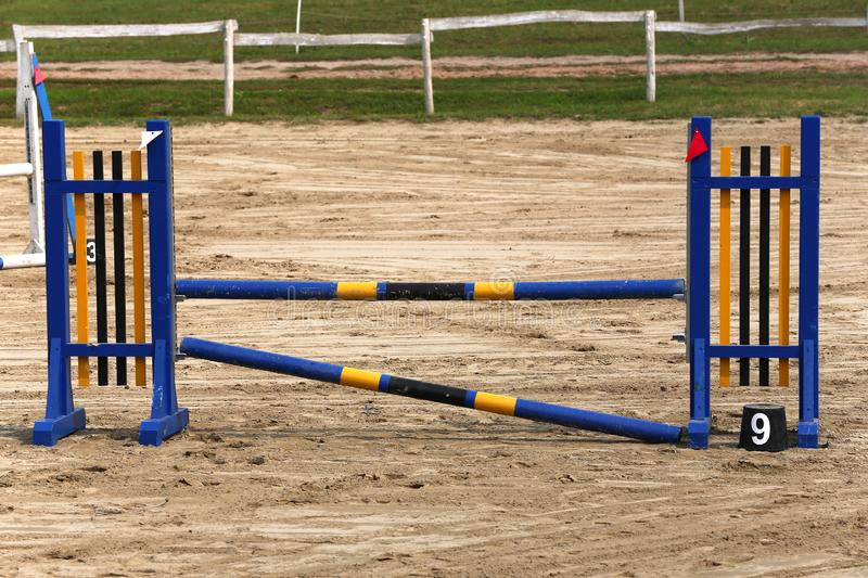 Photo in horizontal position of hurdles for riding trainings. Colorful photo of equestrian obstacles. Empty field for horse jumping event competition stock photo