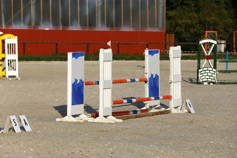 Photo in horizontal position of hurdles for riding trainings. Colorful photo of equestrian obstacles. Empty field for horse jumping event competition stock image