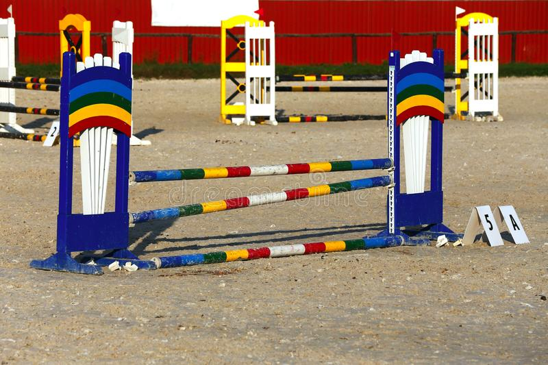 Photo in horizontal position of hurdles for riding trainings. Colorful photo of equestrian obstacles. Empty field for horse jumping event competition royalty free stock photos
