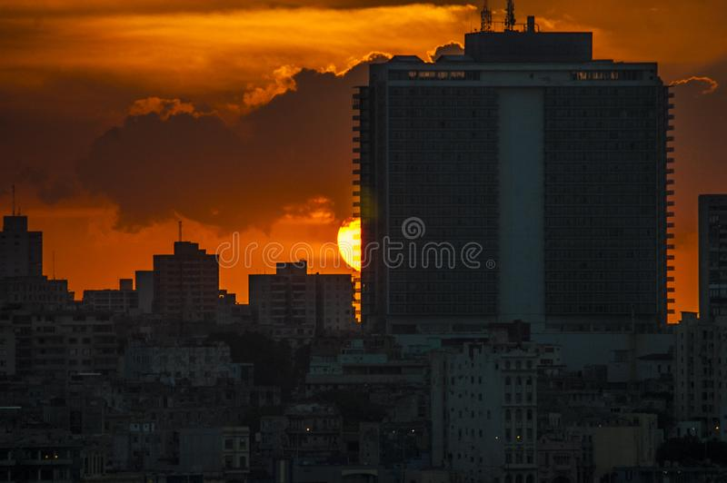 Orange sunset at the Hotel Riviera in Havana, Cuba. royalty free stock image
