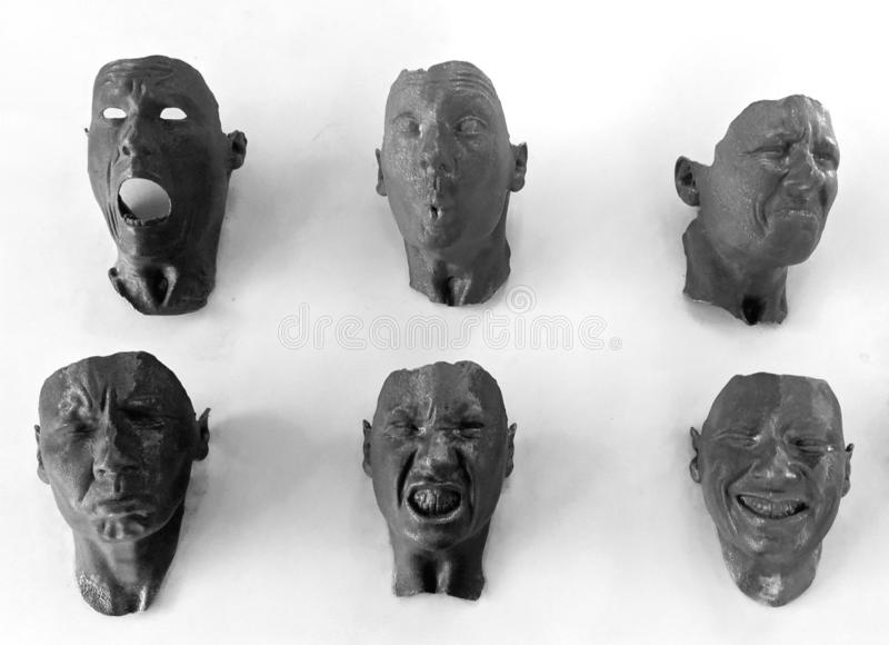 Masks of Different Emotions. Photo of human faces displayed at Science Museum showing different emotions stock photography