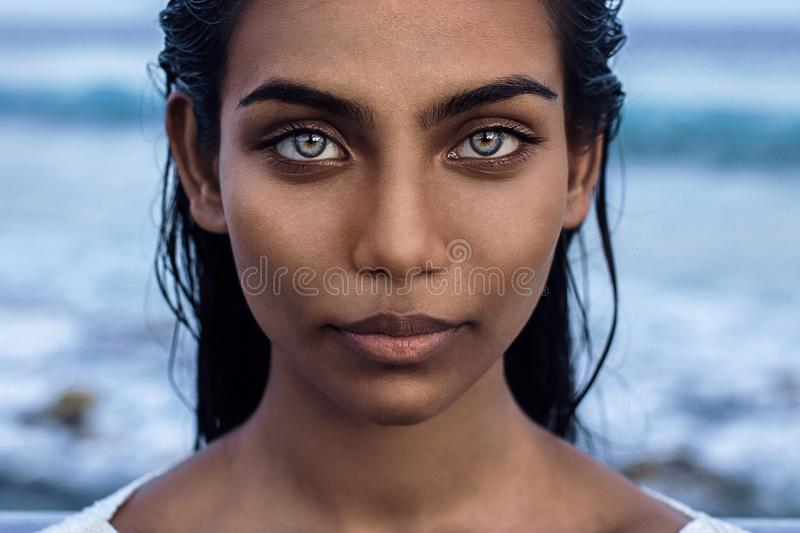 Beautiful indian female portrait with blue eyes. stock photography