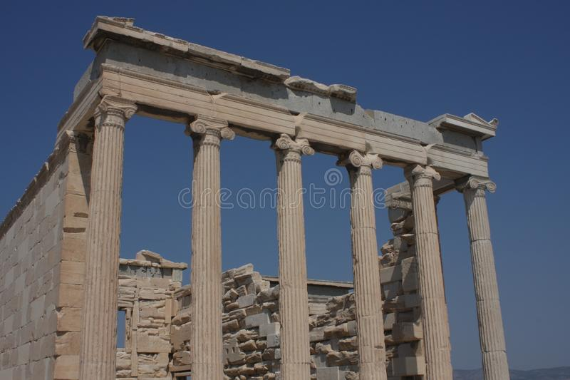 Photo of iconic Erechtheion with famous Caryatids, Acropolis hill, Athens historic center, Attica, Greece.  stock photos
