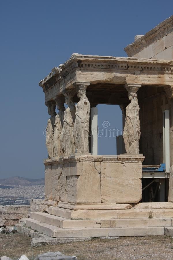 Photo of iconic Erechtheion with famous Caryatids, Acropolis hill, Athens historic center, Attica, Greece.  royalty free stock photos