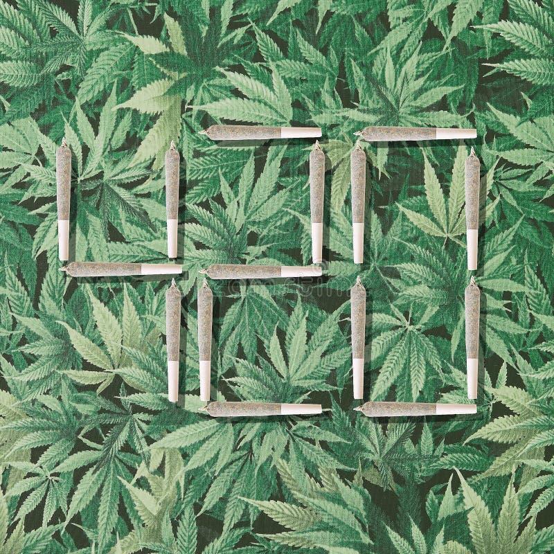 420 Photo illustration on marijuana leaf background. 420 Photo illustration with cannabis joints on marijuana leaf background stock photos