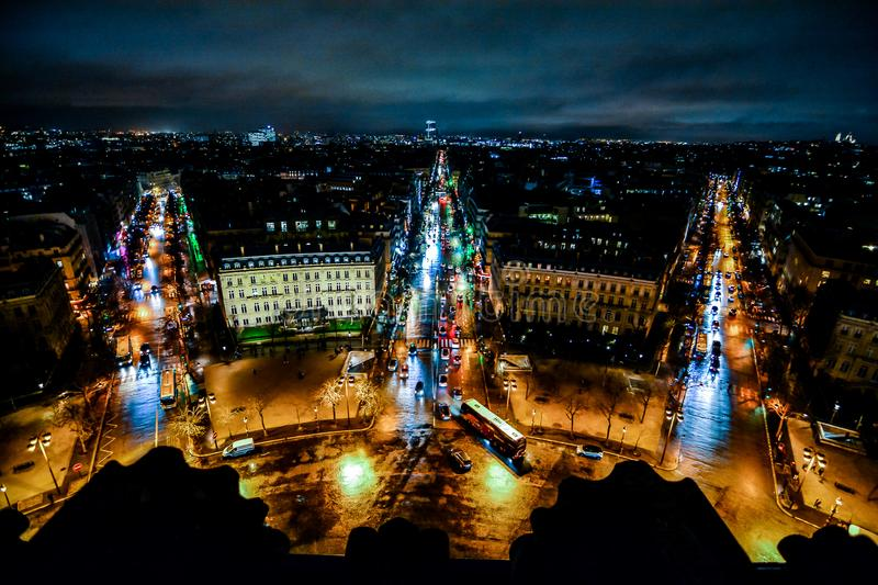 view from Arc de triomphe at night,Photo image a Beautiful panoramic view of Paris Metropolitan City royalty free stock images