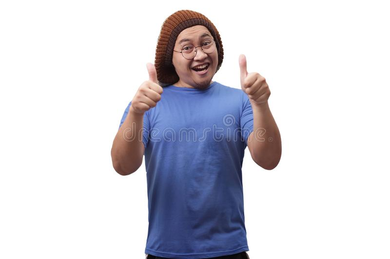 Young Man Showing Thumbs Up Gesture OK Sign royalty free stock images