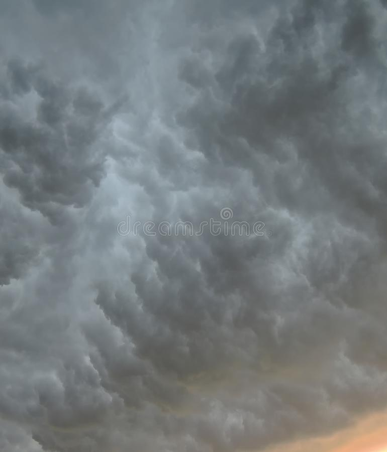 Thunderous clouds. Photo image of thunderous clouds in spring time evening stock image