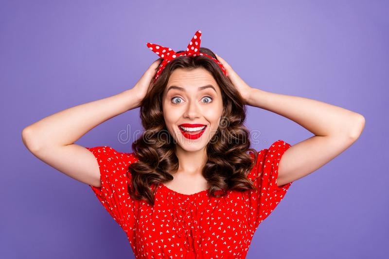 Photo of impressing cute funny nice woman holding her head because of discounts while isolated with purple background royalty free stock photo