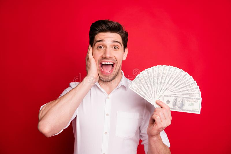 Photo of incredible income of shocked stunned man who does not understand what is going on while isolated with red. Photo of incredible income of shocked royalty free stock photography