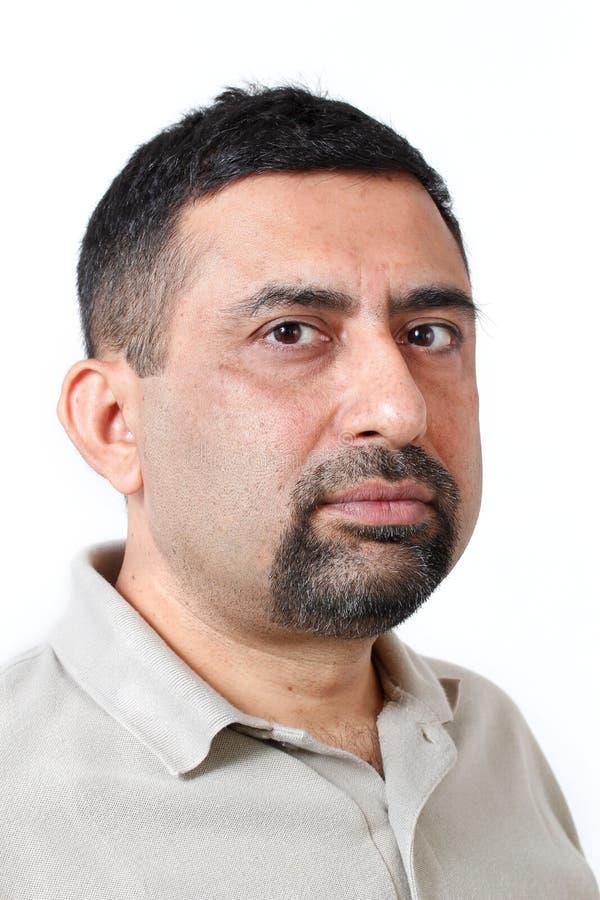 Photo indienne belle de visage d'homme avec le regard prudent photographie stock libre de droits