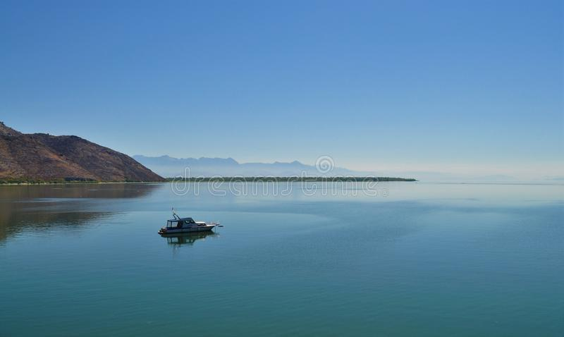 Lake Skadar and a boat stock photography