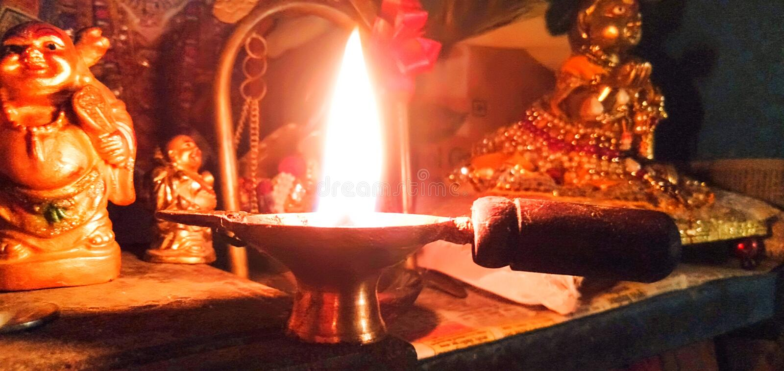 Evening light in the tample. Photo of the lamp that burns in the tample during the evening stock photography